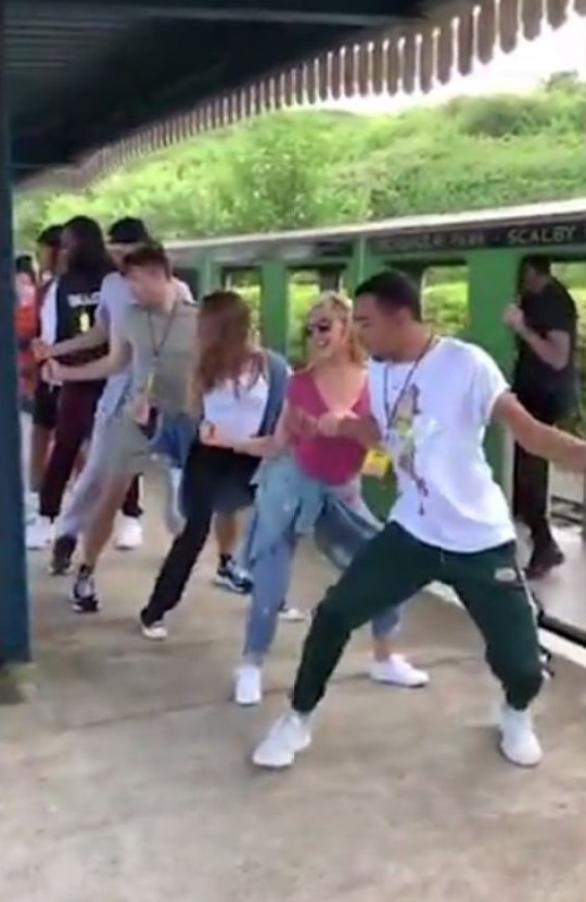 Kylie Minogue dancing on mini railway