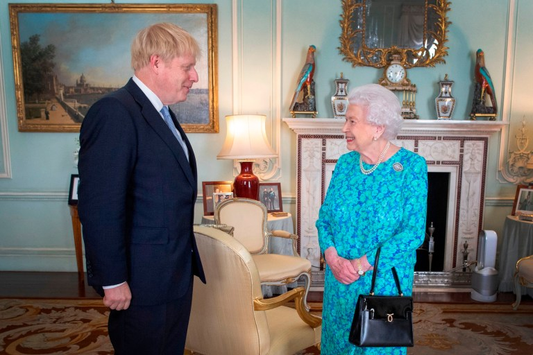 Britain's Queen Elizabeth II welcomes newly elected leader of the Conservative party, Boris Johnson during an audience in Buckingham Palace, London on July 24, 2019, where she invited him to become Prime Minister and form a new government. - Boris Johnson took over as Britain's prime minister Wednesday, promising to pull his country out of the European Union on October 31 by any means necessary. (Photo by Victoria Jones / POOL / AFP) (Photo credit should read VICTORIA JONES/AFP/Getty Images)