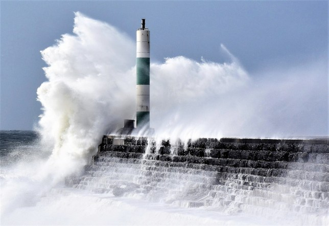High winds and heavy swells cause a dramatic high tide in Aberystwyth, Cardigan Bay, Wales.