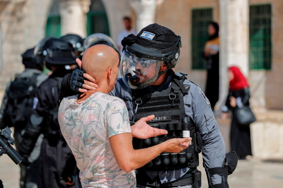 An Israeli soldier scuffles with a Palestinian at the al-Aqsa Mosque compound in the Old City of Jerusalem on August 11, 2019, as clashes broke out during the overlapping Jewish and Muslim holidays of Eid al-Adha and the Tisha B'av holiday inside the historic compound which is considered the third-holiest site in Islam and the most sacred for Jews, who revere it as the location of the two biblical-era temples. - The compound, which includes the Al-Aqsa mosque and the Dome of the Rock, is one of the most sensitive sites in the Israeli-Palestinian conflict. (Photo by Ahmad GHARABLI / AFP)AHMAD GHARABLI/AFP/Getty Images