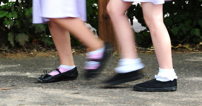 File photo date 15/07/14 of school girls walking to school. Parents across the UK collectively spend nearly ??1.2 billion sending their children back to school, it has been estimated.