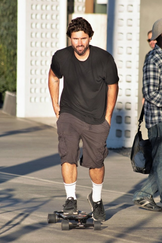Hollywood, CA - *EXCLUSIVE* - Brody Jenner sports a plain black t-shirt and cargo shorts as he's spotted out skateboarding on Sunset Boulevard in Hollywood. The star of 'The Hills: New Beginnings' seemed to be in good spirits, having a quick bite at vegetarian restaurant Veggie Grill, and then zipping around in his electric skateboard while trying to get the skateboard control to function. Jenner didn't seem to let his split with ex Kaitlynn Carter get him down as rumors of him dating model Josie Canseco have recently emerged. Pictured: Brody Jenner BACKGRID USA 13 AUGUST 2019 BYLINE MUST READ: ALEXJR / BACKGRID USA: +1 310 798 9111 / usasales@backgrid.com UK: +44 208 344 2007 / uksales@backgrid.com *UK Clients - Pictures Containing Children Please Pixelate Face Prior To Publication*
