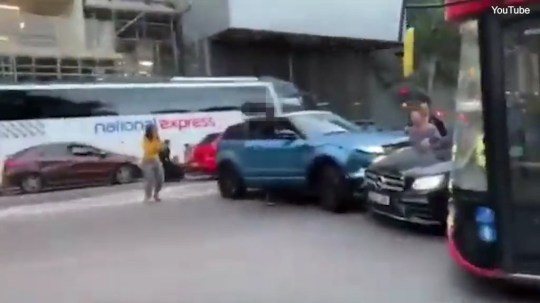 Video shows the woman trapped between cars