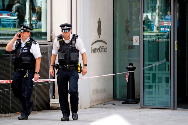 British Police officers leave the entrance to Britain's Home Office in central London on August 15, 2019, following a stabbing incident. - A man was taken to hospital after being stabbed Thursday outside Britain's Home Office interior ministry in London. One man was arrested at the scene on suspicion of grievous bodily harm, the city's Metropolitan Police said. The Home Office is responsible for tackling crime and the government has recently launched a campaign to deter people from carrying blades in a bid to combat the surge in knife crime. (Photo by Tolga AKMEN / AFP)TOLGA AKMEN/AFP/Getty Images