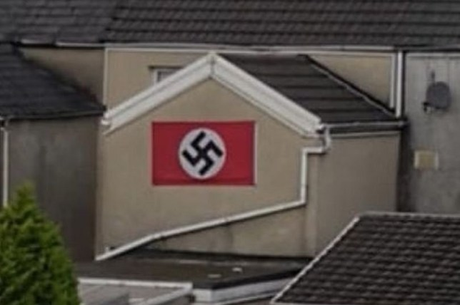 A 55-year-old man has been arrested after a flag with a swastika on it was displayed in Neath. The man has been arrested on suspicion of a racially aggravated public order offence.