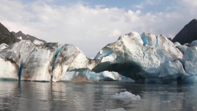 Pieces of the Spencer Glacier fall off, moments before creating a big wave which crashed into a kayaker, in Alaska, U.S., August 10, 2019, in this still image taken from a video obtained from social media. @steeringsouth/via REUTERS THIS IMAGE HAS BEEN SUPPLIED BY A THIRD PARTY. MANDATORY CREDIT. NO RESALES. NO ARCHIVES.