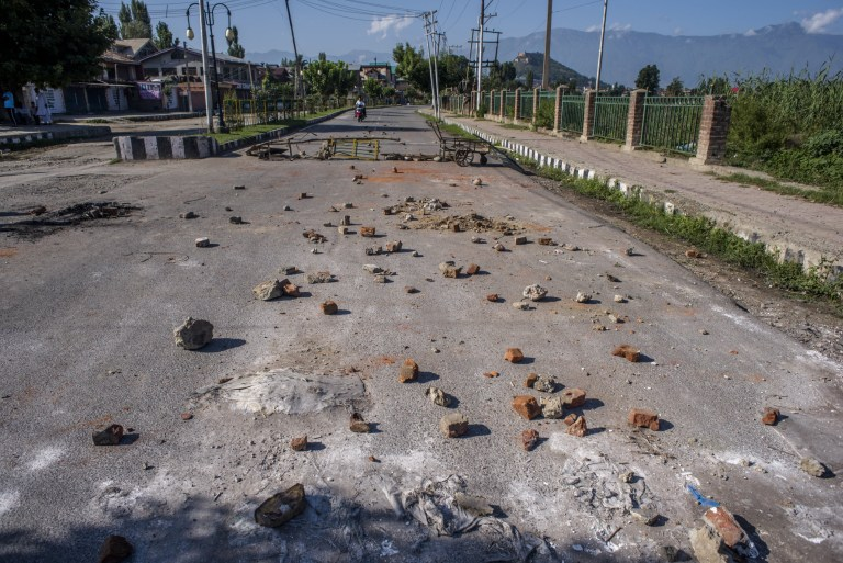 SRINAGAR, KASHMIR, INDIA - AUGUST 18: Stones thrown by Kashmiri protesters at Indian forces lie in the road in the Habba Kadal after a protest against revocation of Article 370 and Article 35A, on August 18, 2019 in Srinagar, the summer capital of Indian administered Kashmir, India. Curfew like restrictions remain in place in Kashmir for the fourteenth consecutive day after India revoked articles 370 and 35A, and phone and internet services also remained suspended. Article 35A of the Indian Constitution was an article that empowered the Jammu and Kashmir state's legislature to define permanent residents of the state and provided special rights and privileges to those permanent residents, also preventing non-locals from buying or owning property in the state. Prior to 1947, Jammu and Kashmir was a princely state under the British Empire. It was added to the Constitution through a Presidential Order. The Constitution Order 1954, (Application to Jammu and Kashmir) was issued by the President of India on 14 May, 1954 in accordance with Article 370 of the Indian Constitution, and with the concurrence of the Government of the State of Jammu and Kashmir. Kashmir has been a state under siege, with both India and Pakistan laying claim to it. Human rights organizations say more than 80,000 have died in the two decade long conflict with the Indian government claiming the number as 42,000. (Photo by Yawar Nazir/ Getty Images)