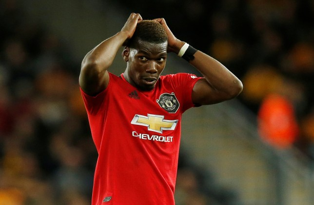 """Soccer Football - Premier League - Wolverhampton Wanderers v Manchester United - Molineux Stadium, Wolverhampton, Britain - August 19, 2019 Manchester United's Paul Pogba reacts after his penalty is saved by Wolverhampton Wanderers' Rui Patricio REUTERS/Andrew Yates EDITORIAL USE ONLY. No use with unauthorized audio, video, data, fixture lists, club/league logos or """"live"""" services. Online in-match use limited to 75 images, no video emulation. No use in betting, games or single club/league/player publications. Please contact your account representative for further details."""