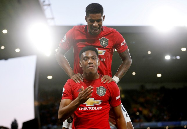 "Soccer Football - Premier League - Wolverhampton Wanderers v Manchester United - Molineux Stadium, Wolverhampton, Britain - August 19, 2019 Manchester United's Anthony Martial celebrates scoring their first goal with teammate Marcus Rashford Action Images via Reuters/Carl Recine EDITORIAL USE ONLY. No use with unauthorized audio, video, data, fixture lists, club/league logos or ""live"" services. Online in-match use limited to 75 images, no video emulation. No use in betting, games or single club/league/player publications. Please contact your account representative for further details. TPX IMAGES OF THE DAY"
