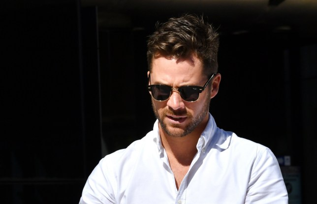 AAP via Press Association Images. Neighbours actor Scott McGregor is seen outside the Southport Magistrates Court on the Gold Coast, Tuesday, August 20, 2019. Danielle Lee, who is an exotic dancer and model, is accused of glassing the Neighbours actor Scott McGregor in a strip club. (AAP Image/Darren England)