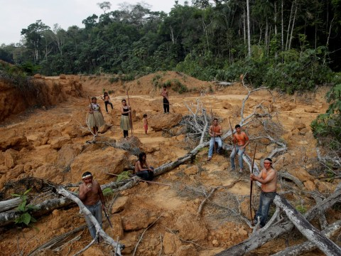 Amazon tribe looks on helplessly as rainforest is destroyed by man and fire