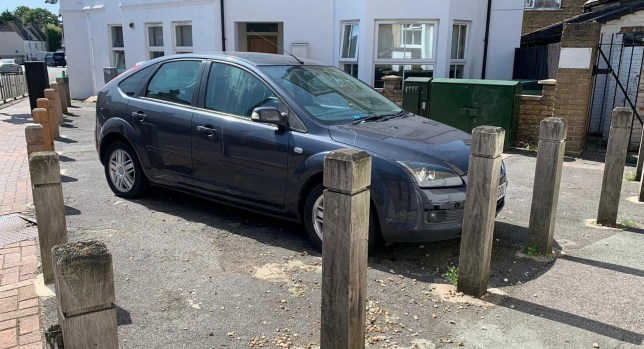 "A parked car was blocked - AFTER three bollards were put up around it. See SWNS story SWOCbollards - A driver hasn't been able to use their car for two weeks after bungling street workers surrounded it with BOLLARDS. The Ford Focus 2007 has been stuck off Eardley Road by Streatham Common, London, for the past TWO weeks after new bollards were installed around it. Local resident Tom Webster said: ""I would estimate that I first saw the car blocked in two or three weeks ago now. ""I was just walking by, when I saw it - and, admittedly, I did do a double-take. ""There used to often be a couple of cars parked there, but one obviously wasn't moved before the posts went up. ""I don't know who it belongs to, and I've not seen anyone by it during that time."" He added: ""It's not something you see very often."""