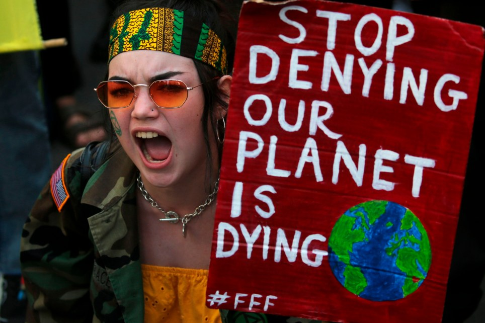 "A protester with a placard that reads ""stop denying our planet is dying"" joins a demonstration organised by climate change activists from Extinction Rebellion outside the Brazilian embassy in central London on August 23, 2019 calling on Brazil to act to protect the Amazon rainforest from deforestation and fire. - Climate change activists demonstrated outside the Brazilian embassy in London on August 23, urging President Jair Bolsonaro to halt the fires in the Amazon rainforest. Protests were also planned for other European cities. Official figures show nearly 73,000 forest fires were recorded in Brazil in the first eight months of the year -- the highest number for any year since 2013. Most were in the Amazon. (Photo by Isabel Infantes / AFP)ISABEL INFANTES/AFP/Getty Images"
