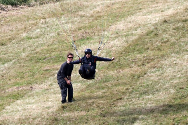 EXCLUSIVE: **PREMIUM EXCLUSIVE RATES APPLY** Movie star Tom Cruise takes his hand to learning to paraglide in the French Alps. The 57 year old actor, who insists on doing his own stunts, took tuition from a top instructor and a team of movie stunt crew. It's believed he is learning to fly as part of an upcoming movie role. He's already hung on the side of a plane and done a HALO jump as part of the Mission Impossible series of films. Pictured: Tom Cruise Ref: SPL5110371 220819 EXCLUSIVE Picture by: swisspixs / / SplashNews.com Splash News and Pictures Los Angeles: 310-821-2666 New York: 212-619-2666 London: 0207 644 7656 Milan: +39 02 56567623 photodesk@splashnews.com World Rights