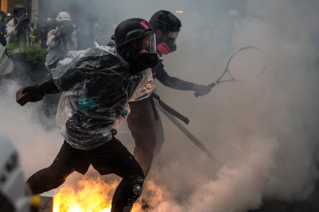 "HONG KONG, CHINA - AUGUST 25: Protesters clash with police after an anti-government rally in Tsuen Wan district on August 25, 2019 in Hong Kong, China. Pro-democracy protesters have continued rallies on the streets of Hong Kong against a controversial extradition bill since 9 June as the city plunged into crisis after waves of demonstrations and several violent clashes. Hong Kong's Chief Executive Carrie Lam apologized for introducing the bill and declared it ""dead"", however protesters have continued to draw large crowds with demands for Lam's resignation and complete withdrawal of the bill. (Photo by Chris McGrath/Getty Images)"
