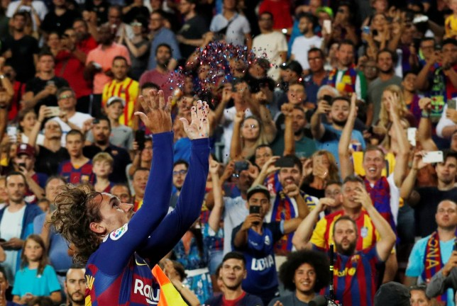 Lionel Messi beams from crowd watching Antoine Griezmann's unusual glitter celebration