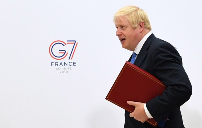 epa07794915 British Prime Minister Boris Johnson walks through the Bellevue hotel during the G7 summit in Biarritz, France, 26 August 2019. The G7 Summit runs from 24 to 26 August in Biarritz. EPA/DYLAN MARTINEZ / POOL