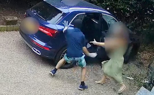 Screen grab of CCTV of a mum protecting her son from car jackers