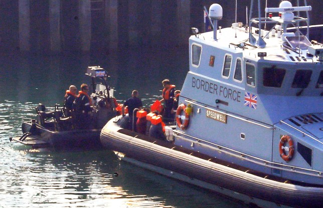 A group of people thought to be migrants are brought to the Port of Dover by Border Force officers after they were intercepted in the Channel in dinghies earlier this morning