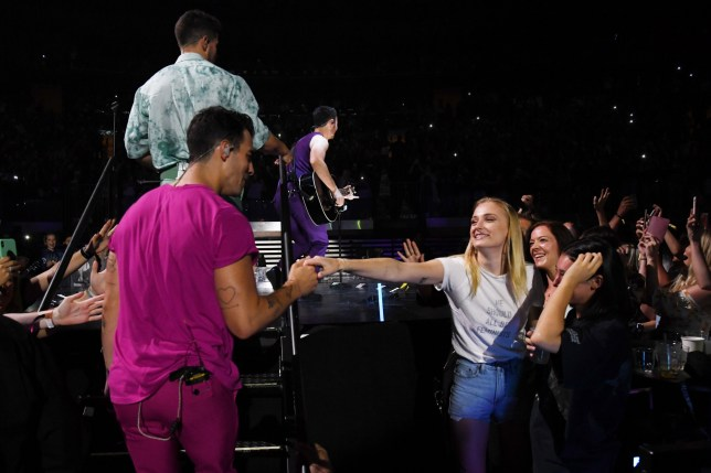 "NEW YORK, NEW YORK - AUGUST 29: Joe Jonas greets Sophie Turner in the audience during Jonas Brothers ""Happiness Begins"" Tour at Madison Square Garden on August 29, 2019 in New York City. (Photo by Kevin Mazur/Getty Images for Philymack)"