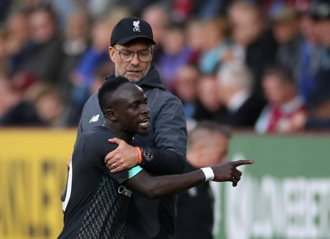 "Soccer Football - Premier League - Burnley v Liverpool - Turf Moor, Burnley, Britain - August 31, 2019 Liverpool's Sadio Mane reacts after being substituted off as manager Juergen Klopp looks on Action Images via Reuters/Carl Recine EDITORIAL USE ONLY. No use with unauthorized audio, video, data, fixture lists, club/league logos or ""live"" services. Online in-match use limited to 75 images, no video emulation. No use in betting, games or single club/league/player publications. Please contact your account representative for further details."