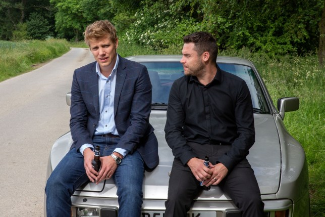 Ryan Hawley as Robert Sugden and Danny Miller as Aaron Dingle on Emmerdale
