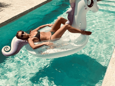 Amanda Holden is a total thirst trap as she lounges on unicorn lilo during Greek holiday