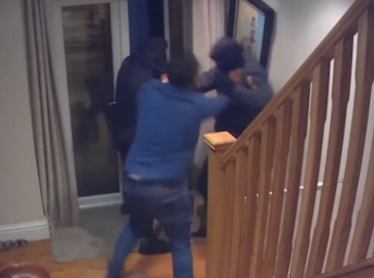 Moment businessman fights off four armed robbers with bare hands