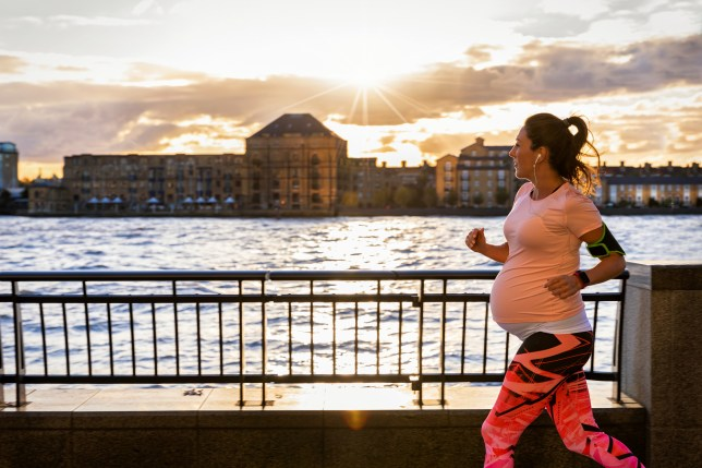 Side View Of Pregnant Woman Running By River In City