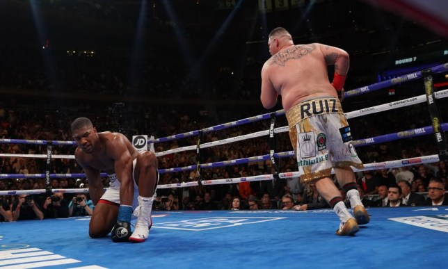 TOPSHOT - England's Anthony Joshua (L) kneels after being knocked down by USA's Andy Ruiz (R) in the 7th round to win by TKO during their 12-round IBF, WBA, WBO & IBO World Heavyweight Championship fight at Madison Square Garden in New York on June 1, 2019. (Photo by TIMOTHY A. CLARY / AFP) (Photo credit should read TIMOTHY A. CLARY/AFP/Getty Images)