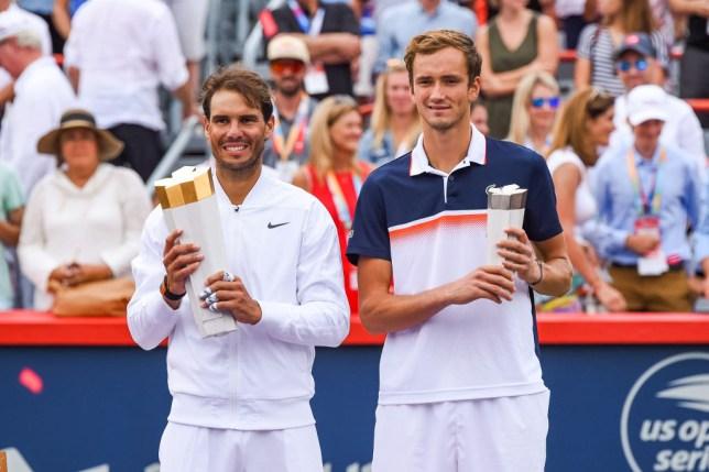 Rafael Nadal stands alongside Daniil Medvedev after their Cincinnati Masters meeting