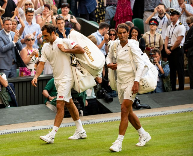 Roger Federer and Rafael Nadal walk side by side at Wimbledon