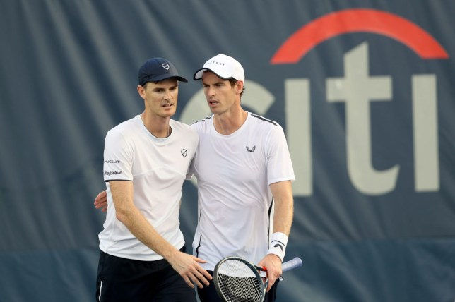 Jamie Murray and Andy Murray embrace after a doubles match