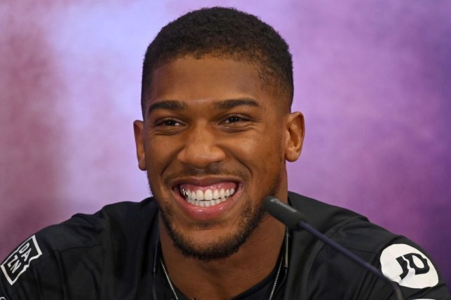 "Britain's Anthony Joshua smiles at promotional press conference for the ""Clash on the Dunes"" fight against Mexican-US WBA, IBF, WBO and IBO heavyweight boxing champion Andy Ruiz Jr due to take place in December, in London on September 6, 2019. - The ""Clash on the Dunes"" is scheduled to take place in Diriya, Saudi Arabia on December 7. (Photo by DANIEL LEAL-OLIVAS / AFP) (Photo credit should read DANIEL LEAL-OLIVAS/AFP/Getty Images)"