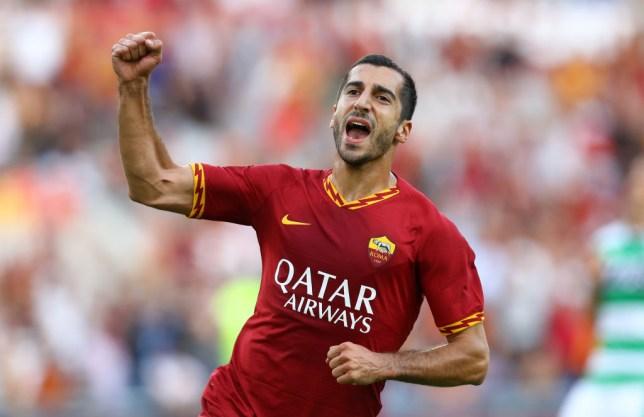 Henrikh Mkhitaryan celebrates after scoring on his Roma debut against Sassuolo on Sunday