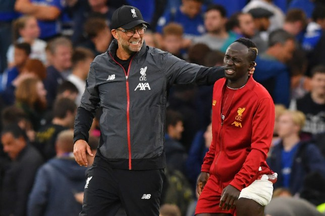 Liverpool's German manager Juergen Klopp (L) gestures to Liverpool's Senegalese striker Sadio Mane (R) on the pitch after the English Premier League football match between Chelsea and Liverpool at Stamford Bridge in London on September 22, 2019. - Liverpool won the game 2-1. (Photo by OLLY GREENWOOD / AFP) / RESTRICTED TO EDITORIAL USE. No use with unauthorized audio, video, data, fixture lists, club/league logos or 'live' services. Online in-match use limited to 120 images. An additional 40 images may be used in extra time. No video emulation. Social media in-match use limited to 120 images. An additional 40 images may be used in extra time. No use in betting publications, games or single club/league/player publications. / (Photo credit should read OLLY GREENWOOD/AFP/Getty Images)