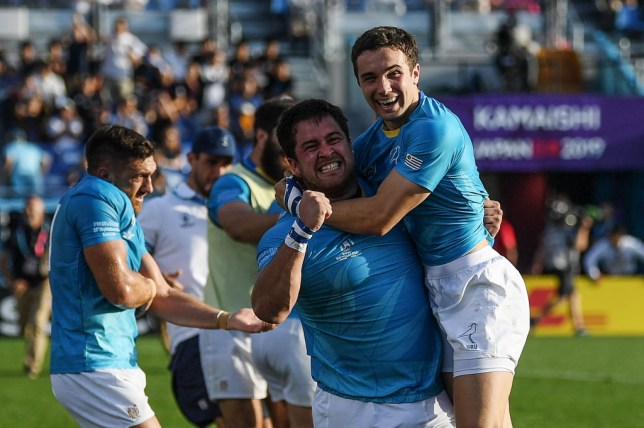Uruguay's full back Felipe Etcheverry (R) and Uruguay's prop Facundo Gattas celebrate after winning the Japan 2019 Rugby World Cup Pool D match between Fiji and Uruguay at the Kamaishi Recovery Memorial Stadium in Kamaishi on September 25, 2019. (Photo by CHARLY TRIBALLEAU / AFP) (Photo credit should read CHARLY TRIBALLEAU/AFP/Getty Images)