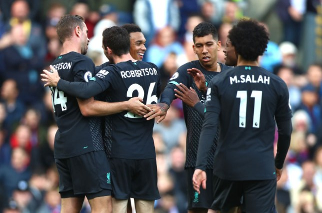 Liverpool player celebrate after Chris Wood's own goal against Burnley