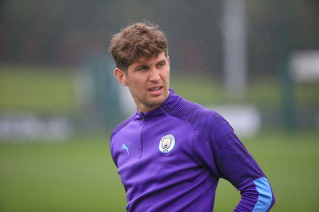 John Stones warms up during Manchester City training