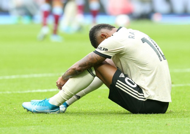 LONDON, ENGLAND - SEPTEMBER 22: Marcus Rashford of Manchester United lies injured during the Premier League match between West Ham United and Manchester United at London Stadium on September 22, 2019 in London, United Kingdom. (Photo by Matthew Peters/Manchester United via Getty Images)