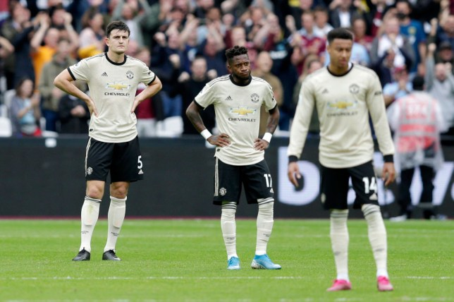 Manchester United players look despondent after their defeat to West Ham