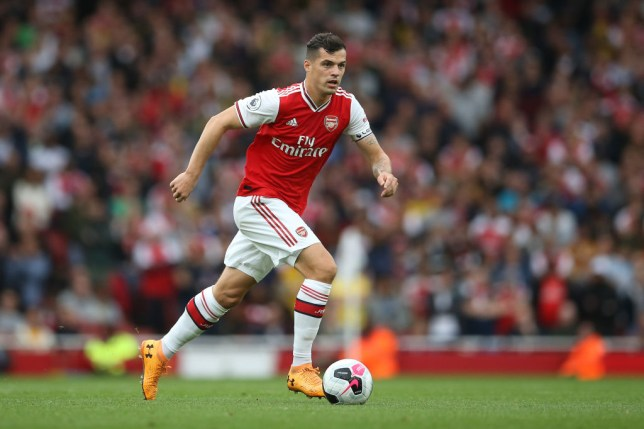Granit Xhaka dribbles with the ball during Arsenal's win against Aston Villa