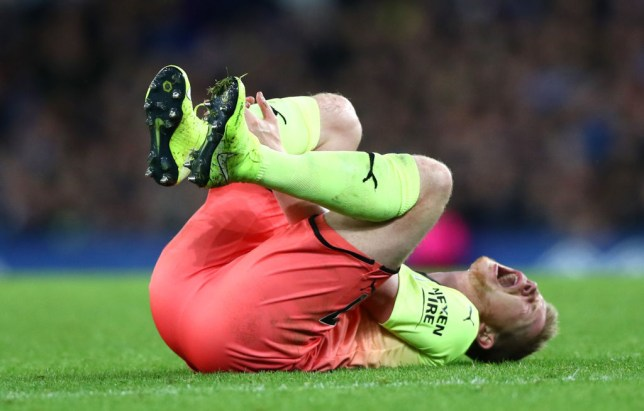 Kevin De Bruyne writhes in pain after being fouled against Everton