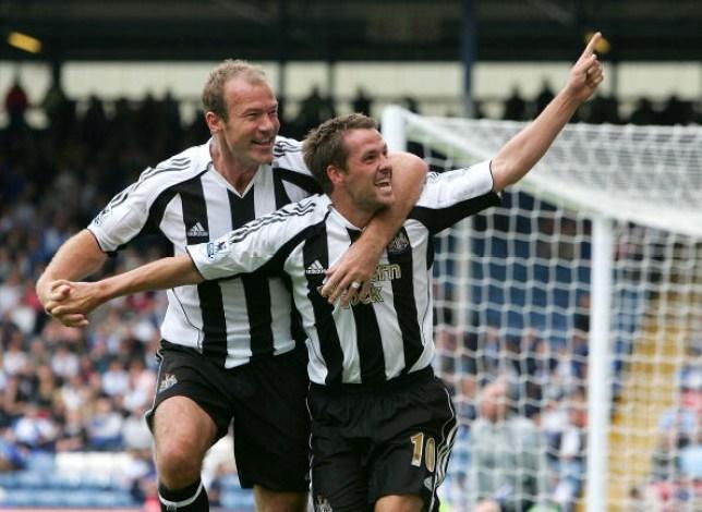 Alan Shearer celebrates alongside Micahel Owen after he scored for Newcastle United