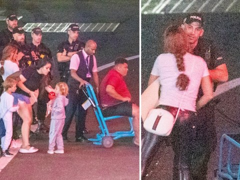 Katie Price kisses airport cops after 2am flight as kids miss first day of school
