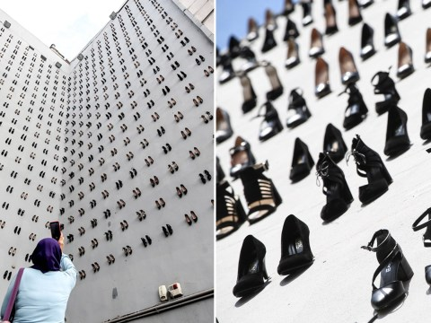 Artist hangs 440 shoes off a building to show how many women were killed by their husbands