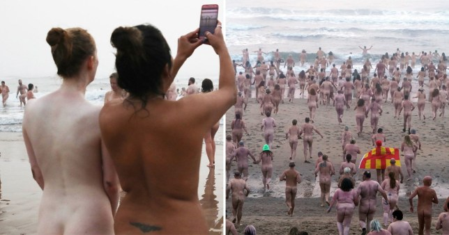 Hundreds of people stripped naked to brave the North Sea for a mass skinny-dip