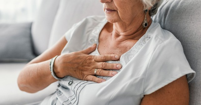 Woman having a heart attack