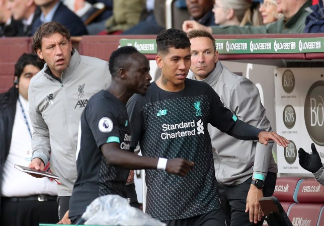 """Soccer Football - Premier League - Burnley v Liverpool - Turf Moor, Burnley, Britain - August 31, 2019 Liverpool's Sadio Mane reacts after being substituted off as Roberto Firmino looks on Action Images via Reuters/Carl Recine EDITORIAL USE ONLY. No use with unauthorized audio, video, data, fixture lists, club/league logos or """"live"""" services. Online in-match use limited to 75 images, no video emulation. No use in betting, games or single club/league/player publications. Please contact your account representative for further details."""