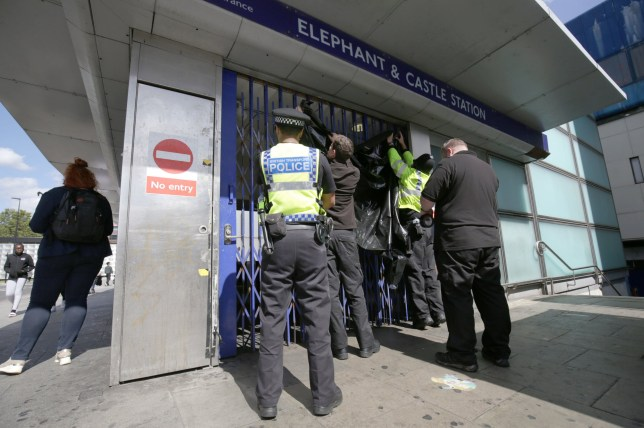 Police close the gates and erect screens at the Elephant and Castle Underground station in south London, as a murder investigation has been launched following the death of a 24-year-old man after he was stabbed at the tube station. The victim was injured during a fight between two groups of men at Elephant and Castle Underground station in south London just before 11.30pm on Sunday. PRESS ASSOCIATION Photo. Picture date: Monday September 2, 2019. See PA story POLICE Stabbing . Photo credit should read: Aaron Chown/PA Wire